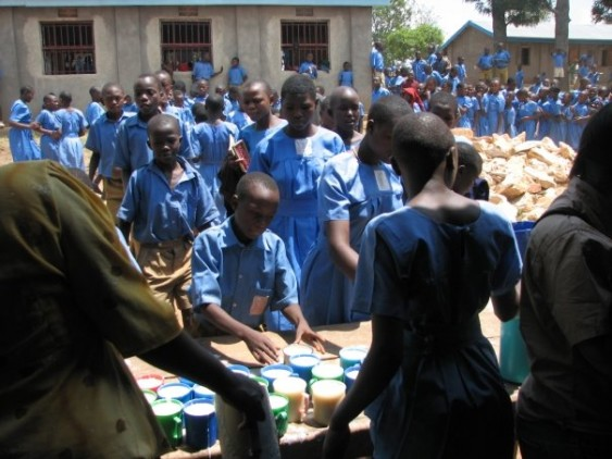 Pupils collecting their lunch time porridge.