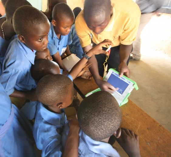 Pupils are shown how to use an XO laptop.
