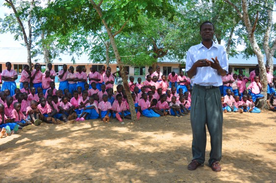 Headteacher Samson Kazungu with some pupils at Kundeni Primary School.