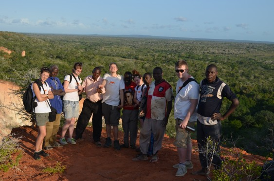 Staff and volunteers with members of Bore Green Umbrella, overlooking Hell's Kitchen.